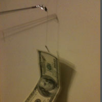 paper money hanging on hook